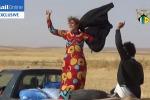 In fuga dall'Isis: le donne siriane si tolgono il velo