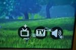 Nell'angolo del televisore le funzioni da attivare. L'utente, ruotando un oggetto o una parte del corpo attiva il controllo (fonte: Lancaster University)