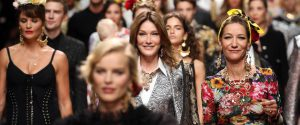 Carla Bruni (C) presents a creation by Dolce&Gabbana during the Milan Fashion Week, in Milan, Italy, 23 September 2018. The Spring Summer 2019 Women's collections are presented at the Milano Moda Donna from 19 to 24 September.ANSA / MATTEO BAZZI