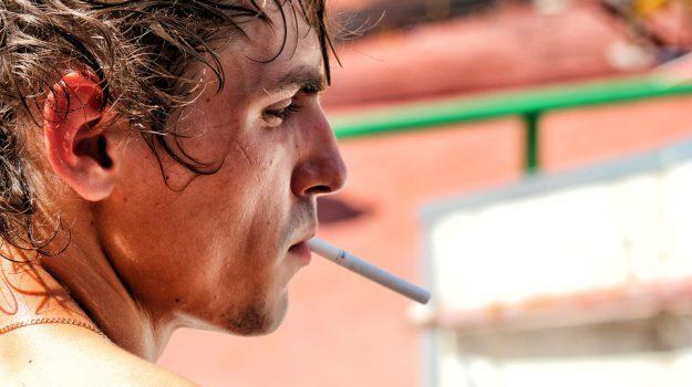 sigarette studio fumo, Sicilia, Società