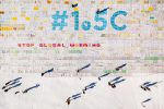epa07170294 A photo taken with a drone shows a giant postcard of approximately 2,500 square meters (50x50 meters) and made of contributions from over 125,000 individual postcards containing messages aiming to fight climate change and global warming, is pictured on the Aletsch glacier near the Jungfraujoch saddle (3,446 meters) by the Jungfrau peak (4,158 meters), Switzerland, 16 November 2018. Each individual postcard includes climate change promises and messages from children and youth originating from 35 countries worldwide and aims to establish the Guinness world record of the largest composed postcard with the most overall contributors. The 1.5 degrees Celcius written in the center of the postcard refers to a target of limiting global warming to 1.5 degrees Celsius. EPA/VALENTIN FLAURAUD