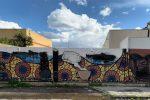 Messina, vandalizzato il murale allo stabilimento Miscela d'Oro: cancellati i riferimenti a migranti e Africa