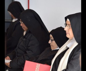 Cloistered nuns return to quake zone, in container