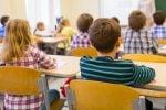 La preside vieta le foto di classe per tutelare la privacy, è polemica