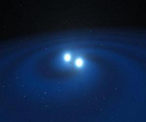 Rappresentazione artistica delle onde gravitazionali generate dalla fusione di due stelle di neutroni (fonte: ESO/L. Calçada/M. Kornmesser)