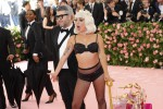epa07552083 Lady Gaga and Brandon Maxwell (L) arrives on the red carpet for the 2019 Met Gala, the annual benefit for the Metropolitan Museum of Art's Costume Institute, in New York, New York, USA, 06 May 2019. The event coincides with the Met Costume Institute's new spring 2019 exhibition, 'Camp: Notes on Fashion', which runs from 09 May until 08 September 2019. EPA/JUSTIN LANE