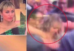 Miley Cyrus afferrata e baciata con la forza da un fan La cantante americana era con il marito Liam Hemsworth in Spagna - CorriereTV