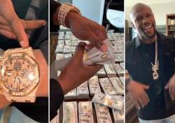 Floyd Mayweather ostenta soldi, gioielli e borse: «Il denaro è il mio tutto». Ed esplode la polemica Il pugile mostra 1,8 milione di dollari in contanti e commenta: «Il denaro mi ha dato tanto e non ho paura di mostrarlo» - Corriere Tv