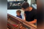 Duetto tra padre e figlio, John Legend al piano con Miles