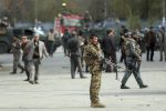 Security forces inspect the site of a deadly blast near a demonstration by hundreds of minority Shiites, in the center of Kabul, Afghanistan, Monday, Nov. 12, 2018. Afghan officials confirmed several people were killed in the explosion near a high school and about 500 meters (yards) from where people gathered to denounce Taliban attacks in Jaghuri and Malistan districts of eastern Ghazni province. (ANSA/AP Photo/Massoud Hossaini) [CopyrightNotice: Copyright 2018 The Associated Press. All rights reserved.]