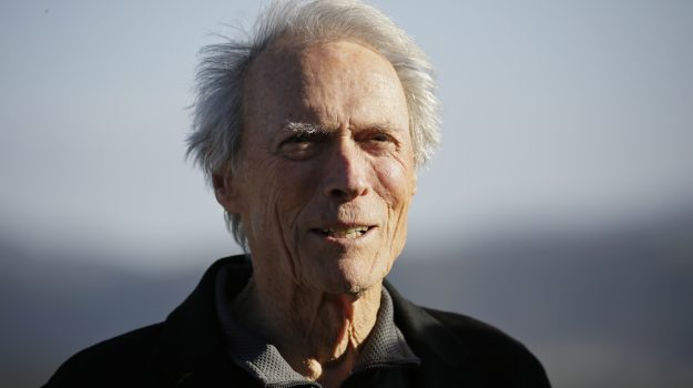 Clint Eastwood stands on the 18th green of the Pebble Beach Golf Links during the awards ceremony of the AT&T Pebble Beach National Pro-Am golf tournament Sunday, Feb. 9, 2020, in Pebble Beach, Calif. (AP Photo/Eric Risberg)