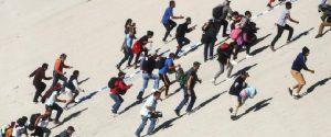 La foto di alcuni migranti pubblicata su Facebook da Musumeci