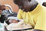 Christine Akello, carries her newly born baby in the maternity ward of Mungula Health Centre III in Adjumani District that serves South Sudanese refugees and host communities. ÒThis place is clean. We have water to clean ourselves. There is water in the sinks in the latrines we useÓ. said Akello. With funding from the Japan Government, UNICEF constructed a motorised solar powered water system that provides clean and safe water in the health facility and in the maternity ward for safe delivery of babies.