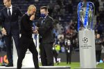 epa09235983 Manchester City manager Pep Guardiola (2-L) reacts after the UEFA Champions League final between Manchester City and Chelsea FC in Porto, Portugal, 29 May 2021. EPA/Pierre-Philippe Marcou / POOL