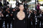 epa09337789 Bella Hadid arrives for the screening of 'Tre Piani' (Three Floors) during the 74th annual Cannes Film Festival, in Cannes, France, 11 July 2021. The movie is presented in the Official Competition of the festival which runs from 06 to 17 July. EPA/SEBASTIEN NOGIER
