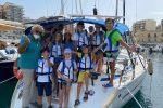 In barca per osservare Reggio da lontano
